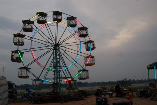 Ferris wheel on Vientiane waterfront. Not exactly the London Eye.
