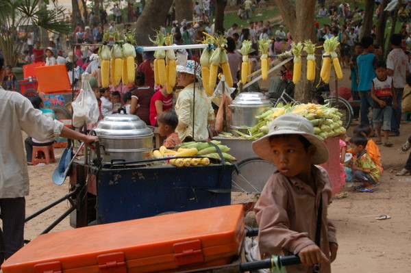 Kid selling drinks from a big orange crate